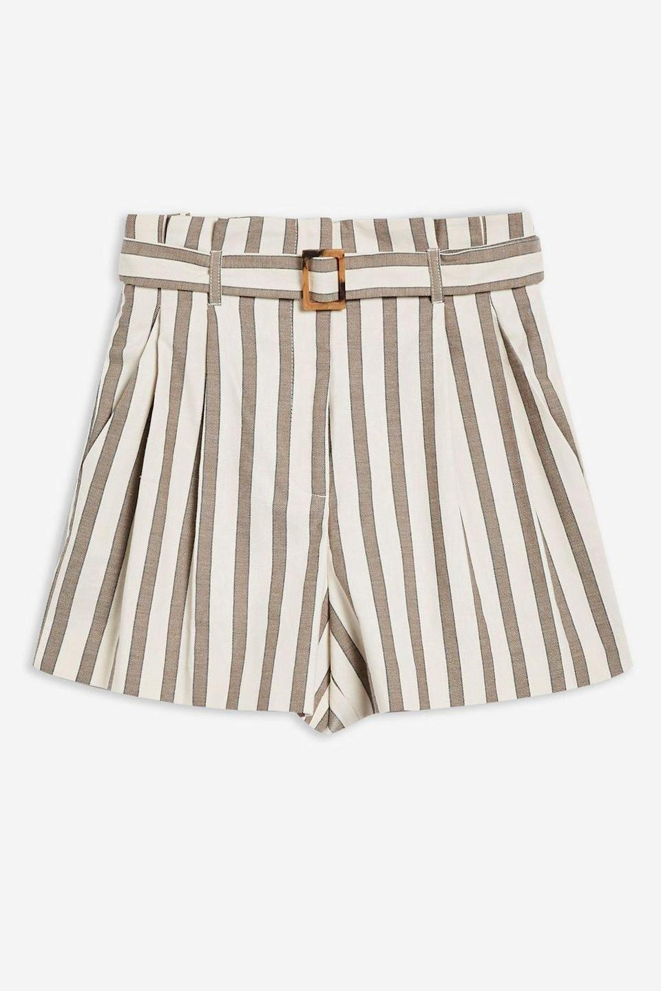 "<p><span>These high-waisted, belted shorts with universally flattering vertical stripes are perfect for those that hate themselves in denim cutoffs. </span><br><em><a href=""http://www.topshop.com/en/tsuk/product/new-in-this-week-2169932/new-in-fashion-6367514/taupe-striped-shorts-7730649?bi=0&ps=20"" rel=""nofollow noopener"" target=""_blank"" data-ylk=""slk:Buy here."" class=""link rapid-noclick-resp""><span>Buy here.</span></a></em> </p>"