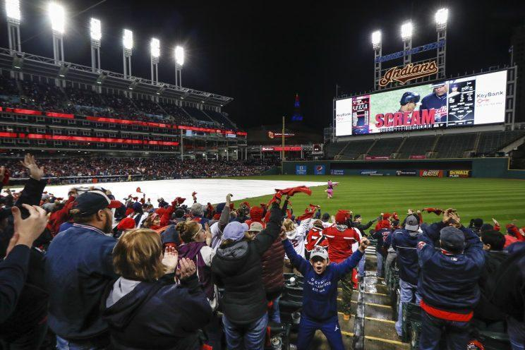 Cleveland Indians fans react after Francisco Lindor is seen hitting an RBI single during a Game 5 watch party of the Major League Baseball World Series against the Chicago Cubs at Progressive Field, Sunday, Oct. 30, 2016, in Cleveland. (AP Photo/John Minchillo)