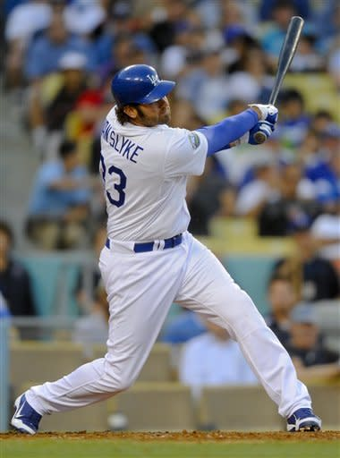 Los Angeles Dodgers' Scott Van Slyke hit a t two-run home run to left field in the seventh inning of a baseball game against the St. Louis Cardinals, Sunday, May 20, 2012, in Los Angeles. (AP Photo/Gus Ruelas)