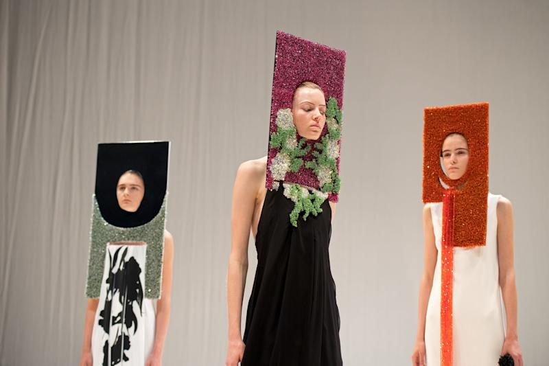 Models present creations by British designer Hussein Chalayan during his catwalk at London Fashion Week on Sept. 17.  (CHRIS J RATCLIFFE via Getty Images)