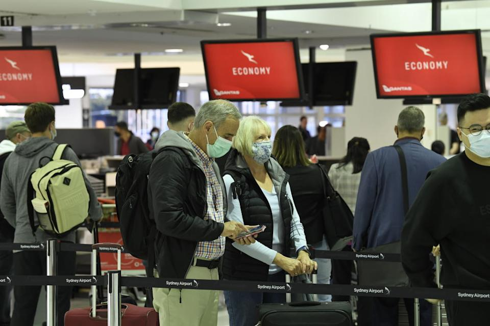 Passengers lining up to check in for Qantas flight QF143, an Airbus A330, the first one for the airline to New Zealand as it travels out of Sydney's International Airport en route from Australia to New Zealand.