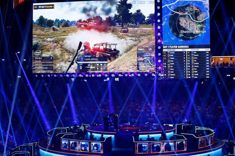 Players are pictured as they attend the PUBG Global Invitational 2018, the first official esports tournament for the computer game PlayerUnknown's Battlegrounds in Berlin