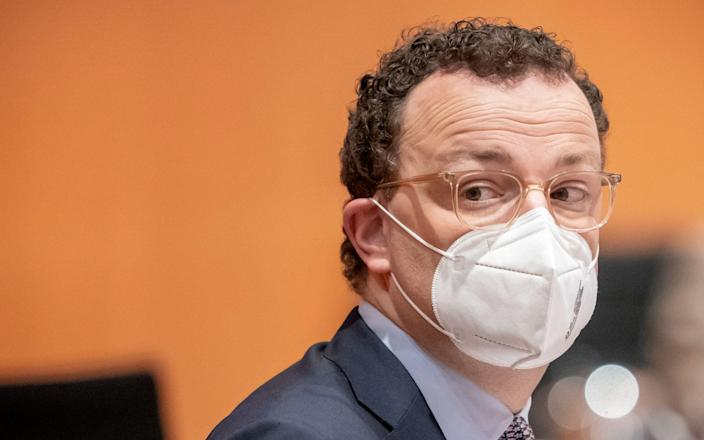 German Health Minister Jens Spahn wears a protective face mask as he arrives for the weekly cabinet meeting of the German government at the chancellery in Berlin, Germany, March 3, 2021. Michael Kappeler/Pool via REUTERS - MICHAEL KAPPELER/ via REUTERS