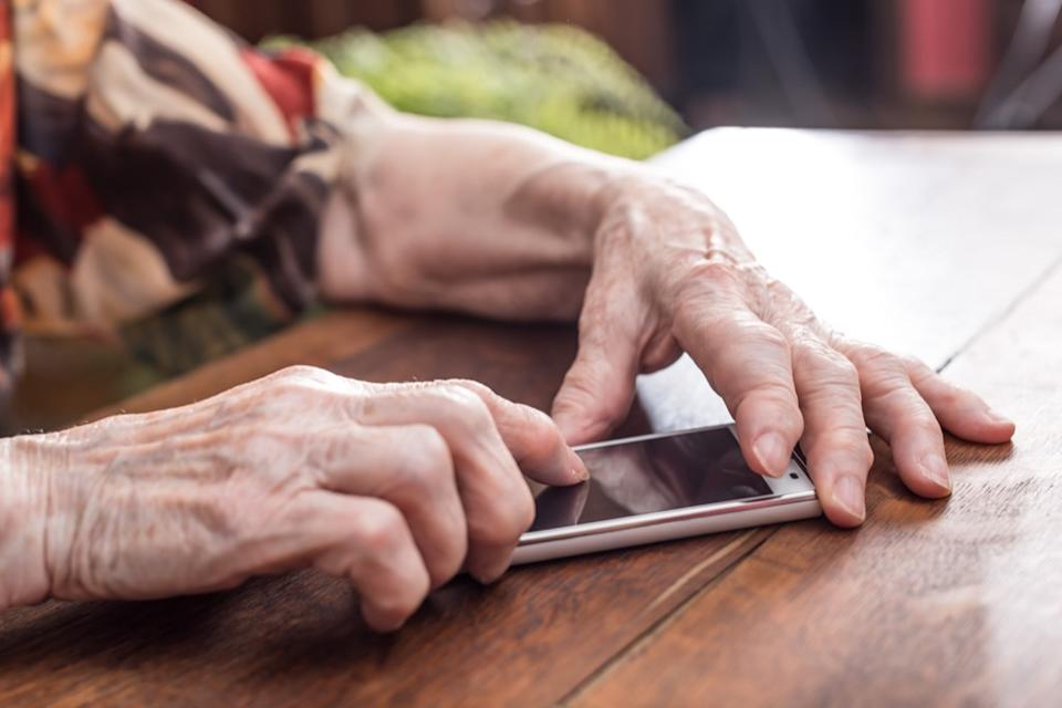 old person using smartphone