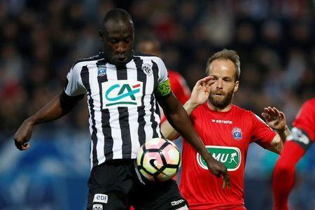 Soccer Football - SCO Angers v EA Guingamp - French Cup Semi-Final - Raymond Kopa Stadium, Angers, France - 25/04/2017. Guingamp's Etienne Didot and Angers' Cheikh Ndoye in action. REUTERS/Stephane Mahe