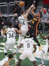 Atlanta Hawks guard Trae Young passes against Milwaukee Bucks defender Pat Connaughton during the first half of game 2 in the NBA Eastern Conference Finals on Friday, June 25, 2021, in Milwaukee. (Curtis Compton/Atlanta Journal-Constitution via AP)