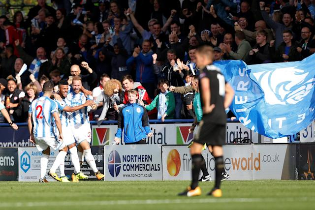 <p>Huddersfield Town's Laurent Depoitre celebrates scoring their first goal Action Images via Reuters/Ed Sykes </p>