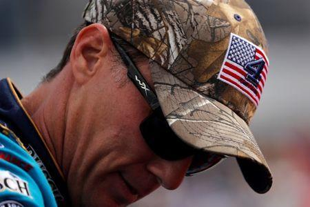 Driver Kevin Harvick wears a camouflage hat with his number and a U.S. flag before the start of the Monster Energy NASCAR Cup Series Apache Warrior 400 race in Dover, Delaware, U.S. October 1, 2017. REUTERS/Jonathan Ernst