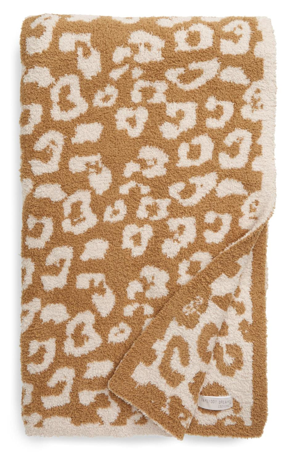 Barefoot Dreams In the Wild Throw Blanket. Image via Nordstrom.