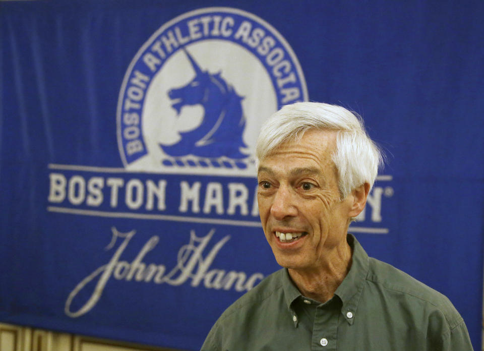 FILE - In this April 13, 2017, file photo, Ben Beach arrives at a media availability at the Copley Plaza Hotel near the Boston Marathon finish line in Boston. Ben Beach has experienced a little bit of everything while running in a record 53 consecutive Boston Marathons — from New England's unpredictable weather to a diagnosis with dystonia to the 2013 bombing to last year's pandemic disruption. (AP Photo/Stephan Savoia, File)