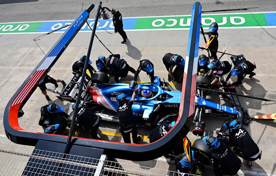 Alpine's mechanics work on the car of Alpine's Spanish driver Fernando Alonso in the pit lane during a practice session at the Autodromo Internazionale Enzo e Dino Ferrari race track in Imola, Italy, on April 17, 2021, on the eve of the Formula One Emilia Romagna Grand Prix. (Photo by MIGUEL MEDINA / AFP) (Photo by MIGUEL MEDINA/AFP via Getty Images)
