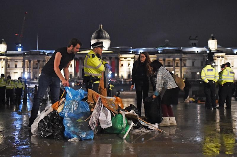 Protesters gather their belongings as police work to remove the last of the Extinction Rebellion demonstration in Trafalgar Square, central London. (Photo by David Mirzoeff/PA Images via Getty Images)