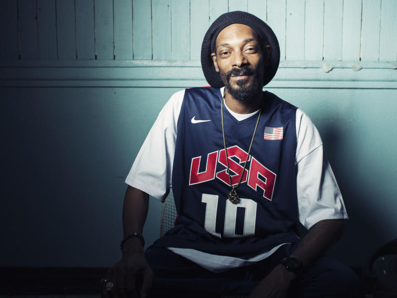 """This Monday, July 30, 2012 photo shows Snoop Dogg, who now goes by Snoop Lion, posing for a portrait at Miss Lily's in New York. Snoop Dogg says he was """"born again"""" during a visit to Jamaica in February, changed his name to Snoop Lion and is ready to make music that his """"kids and grandparents can listen to.""""  The artist known for gangster rap is releasing a reggae album called """"Reincarnated"""" in the fall.  (Photo by Victoria Will/Invision/AP)"""