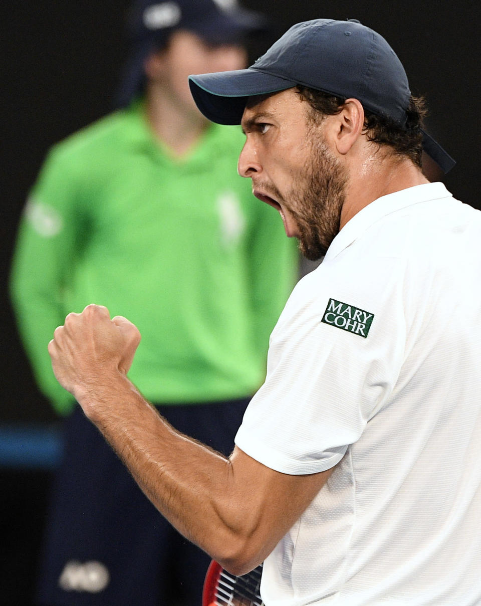 Russia's Aslan Karatsev reacts after winning a point against Serbia's Novak Djokovic during their semifinal match at the Australian Open tennis championship in Melbourne, Australia, Thursday, Feb. 18, 2021.(AP Photo/Andy Brownbill)