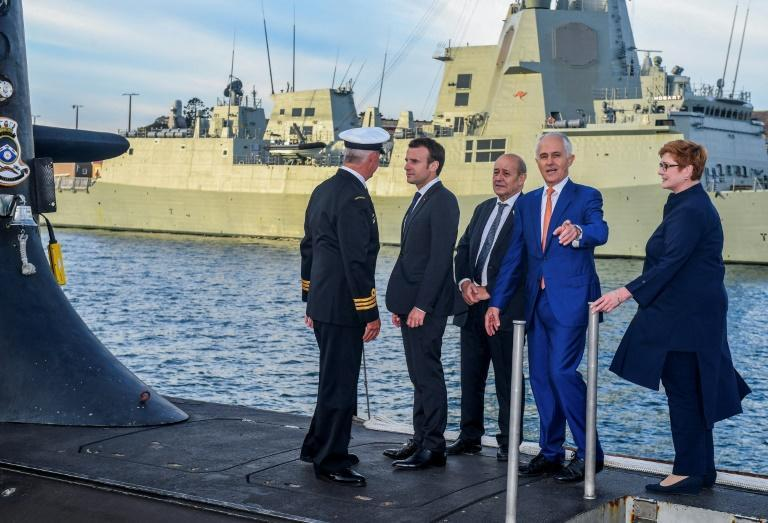 French President Emmanuel Macron and Australia's then prime minister Malcolm Turnbull stand on the deck of HMAS Waller submarine in May 2018 in Sydney as Paris fulfilled a major new contract that has since been scrapped (AFP/BRENDAN ESPOSITO)