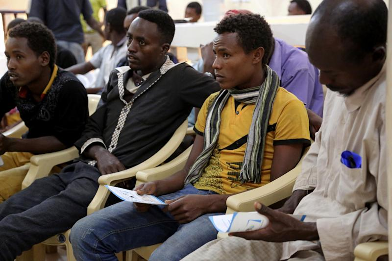 In this photo taken on Monday, Jan. 2, 2017, Ethiopian migrants gather at the International Organization for Migration center in the port city of Aden, Yemen. Despite Yemen's civil war, migrants from Ethiopia and Saudi Arabia are streaming in, hoping to make their way to wealthy Saudi Arabia. Instead, they often meet torture, rape and imprisonment at the hands of smugglers. (AP Photo/Maad Al-Zikry)