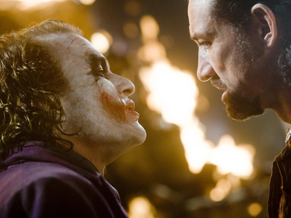 <p>So serious: The Joker (Health Ledger) squares up to Chechen (Ritchie Coster) in 2008's The Dark Knight</p>Warner Bros