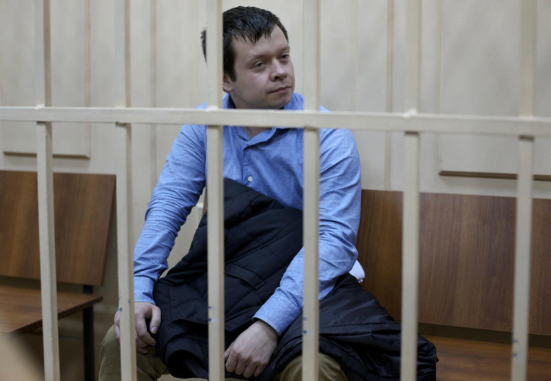 Leftist activist Konstantin Lebedev sits in a defender's cage during a trial in Moscow, Thursday, Oct. 18, 2012. Russia's top investigative agency filed criminal charges Thursday against Konstantin Lebedev, an assistant of opposition leader Sergei Udaltsov, continuing a widespread crackdown on the movement against President Vladimir Putin. The Investigative Committee said in a statement that Left Front member Konstantin Lebedev has been charged with plotting mass riots and could face a jail term of up to ten years. (AP Photo/Ivan Sekretarev)