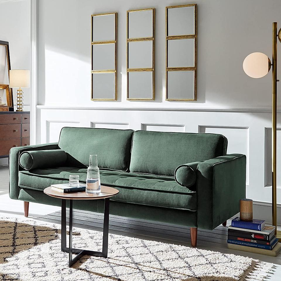 <p>We love the mid-century look of this <span>Rivet Aiden Mid-Century Modern Tufted Loveseat Sofa</span> ($845). With the tufted bench seat, tapered wood legs, and bolster pillows, it provides the right mix of style and comfort.</p>