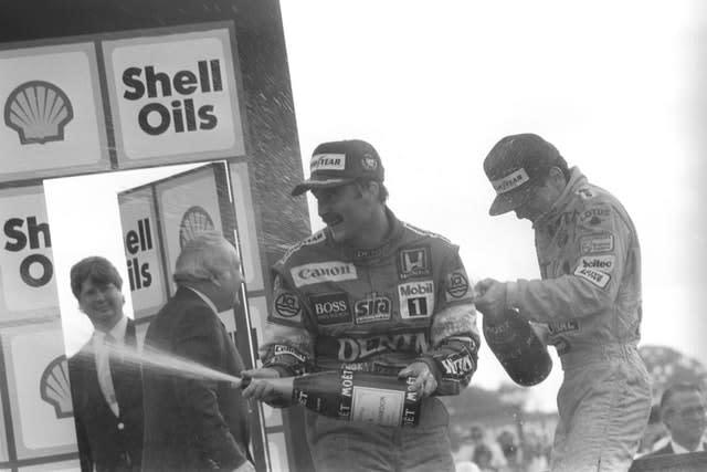 Nigel Mansell, left, was this time victorious at the British Grand Prix with third-placed Senna, right, also on the podium (PA)
