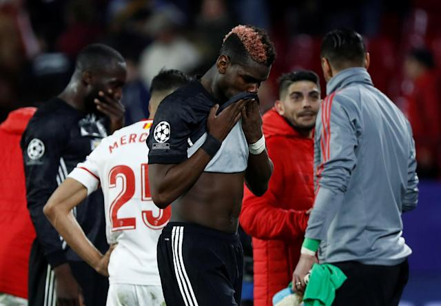 Soccer Football - Champions League Round of 16 First Leg - Sevilla vs Manchester United - Ramon Sanchez Pizjuan, Seville, Spain - February 21, 2018 Manchester United's Paul Pogba looks dejected after the match REUTERS/Juan Medina