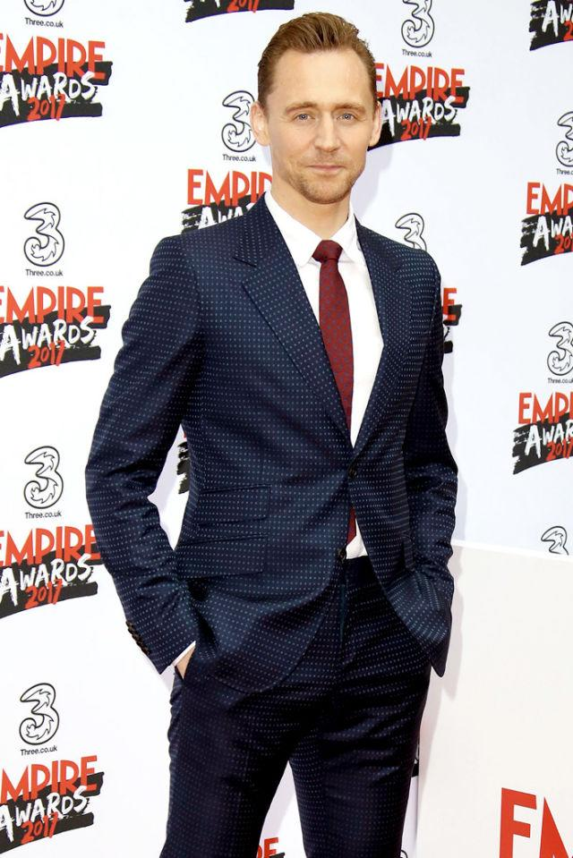 <p>Lately Hiddleston has become the king of the subtly patterned suit. In this case, pin dot is the perfect way to add a little unexpected personality to an otherwise traditional navy. </p>