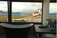 """<p>If your idea of holiday heaven is a bolthole in the middle of the wilderness, then Croft 103 cottages are for you. Situated on the shores of Loch Eriboll near Durness in North West Sutherland, Scotland, the buildings fuse contemporary eco design with traditional craftsmanship. Quite frankly, who wouldn't be tempted by a warm bath overlooking the sweeping Scottish landscape - there's even an alfresco bathtub for the truly brave. Come in the winter and be in with a chance of seeing the Northern Lights.</p><p>For more information visit <a href=""""https://www.i-escape.com/croft-103"""" rel=""""nofollow noopener"""" target=""""_blank"""" data-ylk=""""slk:i-escape.com"""" class=""""link rapid-noclick-resp"""">i-escape.com</a></p>"""