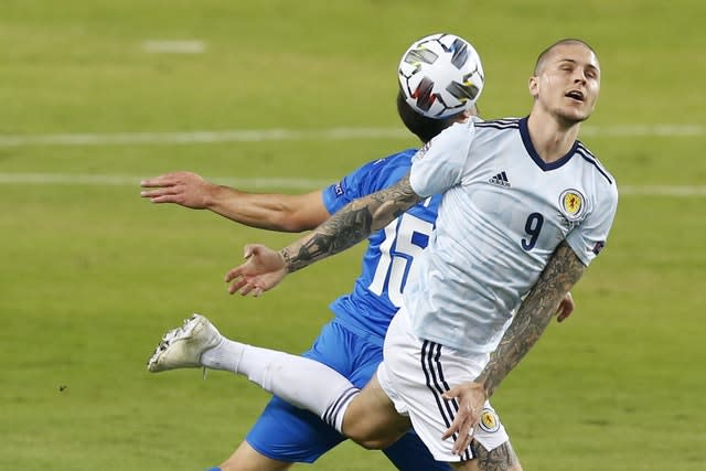 Scotland's Lyndon Dykes fights for the ball with Israel's Neta Lavi