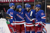 New York Rangers defenseman Anthony Bitetto (22), third from left, celebrates his goal with right wing Kaapo Kakko (24), left wing Artemi Panarin (10) and center Ryan Strome (16) during the second period of a preseason NHL hockey game against the Boston Bruins, Tuesday, Sept. 28, 2021, at Madison Square Garden in New York. (AP Photo/Corey Sipkin).