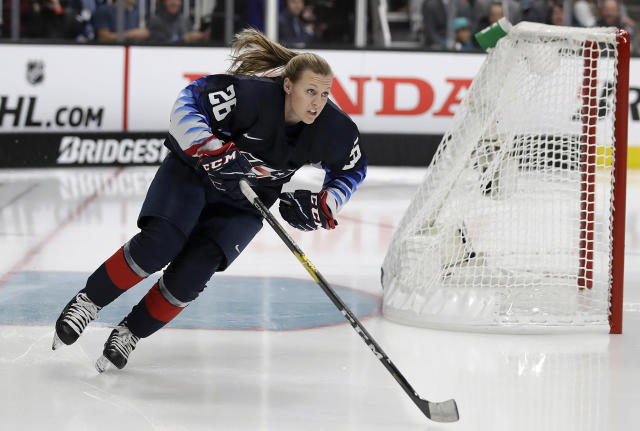 FILE - In this Jan. 25, 2019, file photo, United States' Kendall Coyne Schofield skates during the Skills Competition, part of the NHL All-Star weekend, in San Jose, Calif. The NHL couldn't help but take notice of the buzz Coyne Schofield infused into its midseason showcase of top talent. Chief Content Officer Steve Mayer, who oversees the all-star game's production, chuckled in saying he was already dreaming up ideas to add women players to the event before Coyne Schofield completed her lap. (AP Photo/Ben Margot, File)