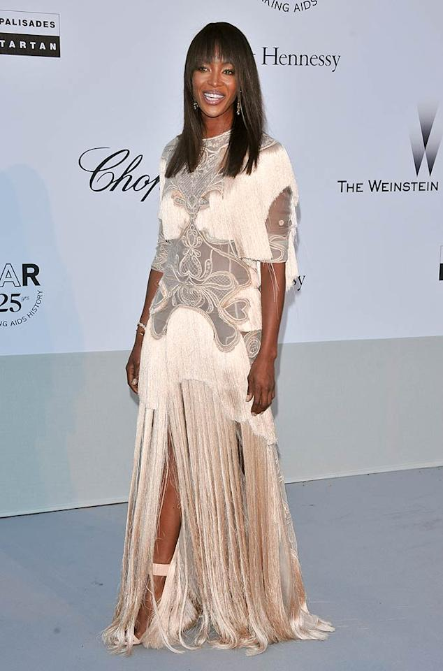 """Naomi Campbell is undoubtedly a supermodel, but she's not always a super dresser. What do you think of the fringe-adorned Givenchy dud she wore to amfAR's Cinema Against AIDS Gala? Fierce or fug? George Pimentel/<a href=""""http://www.filmmagic.com/"""" target=""""new"""">FilmMagic.com</a> - May 19, 2011"""