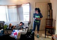 FILE PHOTO: Sincere Bell, 12, chats with his mother, Leanne Bell, 39, surrounded by moving boxes at the army base housing allocated to their family in Fort Hood, Texas, U.S. May 16, 2019. Bell and her husband, Spc. Tevin Mosley, 26, say they are vacating the home immediately after Mosley's military service contract expires in May. The family says they have experienced severe breathing issues, rashes, depression and hair loss, they believe is attributed to a mold infestation since moving into the home 3 years ago. REUTERS/Amanda Voisard