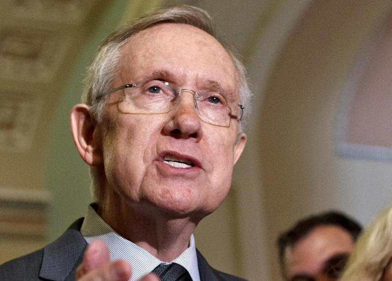 FILE - In this June 5, 2012 file photo, Senate Majority Leader Harry Reid, D-Nev. speaks on Capitol Hill in Washington. Uniforms for U.S. Olympic athletes are American red, white and blue _ but made in China. That has members of Congress fuming. Republicans and Democrats railed Thursday about the U.S. Olympic Committee's decision to dress the U.S. team in Chinese manufactured berets, blazers and pants while the American textile industry struggles economically with many U.S. workers desperate for jobs. (AP Photo/J. Scott Applewhite, File)