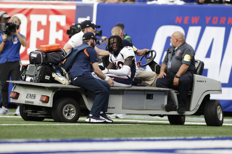 Denver Broncos wide receiver Jerry Jeudy (10) is carted off the field during the second half of an NFL football game against the New York Giants Sunday, Sept. 12, 2021, in East Rutherford, N.J. (AP Photo/Adam Hunger)