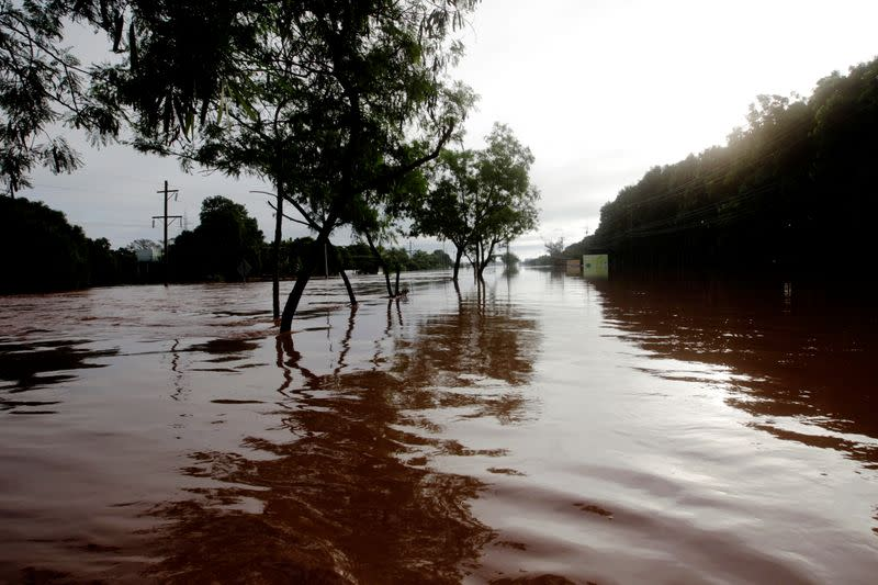 A general view shows a road flooded by the Chamelecon River due to heavy rain caused by Storm Iota, in La Lima