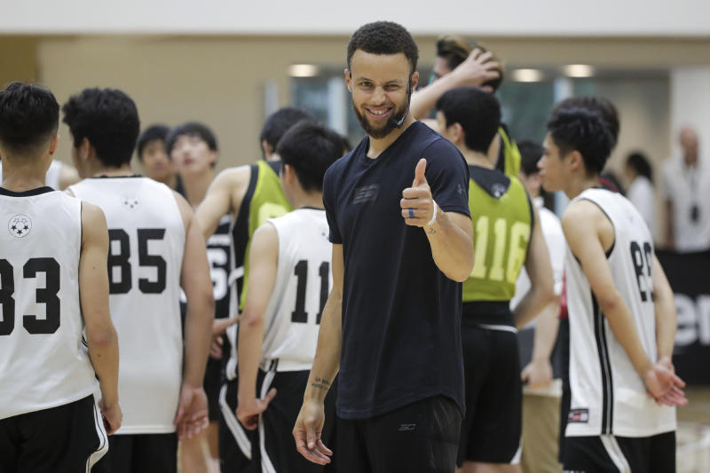 Golden State Warriors' Stephen Curry gives a thumb up while coaching at a high school basketball camp Sunday, June 23, 2019, in Tokyo. Curry is already looking ahead to the next challenge in his basketball career, including the chance to represent the United States at next year's Tokyo Olympics. (AP Photo/Jae C. Hong)