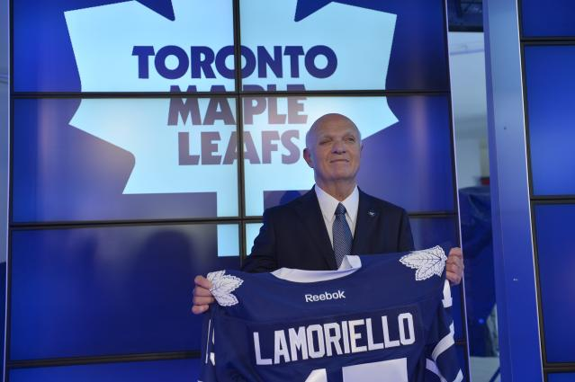 Lou Lamoriello holds up a jersey at a news conference to announce that he has been named the new general manager of the Toronto Maple Leafs, in Toronto, Thursday, July 23, 2015. (Galit Rodan/The Canadian Press via AP)