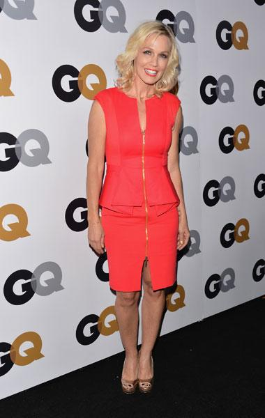 "Jennie Garth: The 40-year-old former ""Beverly Hills 90210"" star looks radiant in a peplum style red dress at the GQ Men of the Year Party on Nov. 13, 2012. But forget being modest; the star takes a risk with a racy gold zipper that travels all the way up the front of the dress and leaves two suggestive slits on the skirt and top.  (Photo by Alberto E. Rodriguez/Getty Images)"