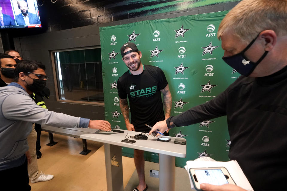 Dallas Stars center Tyler Seguin smiles as he arrives to speak to reporters after his NHL hockey practice session in Frisco, Texas, Thursday, Sept. 23, 2021. (AP Photo/LM Otero)