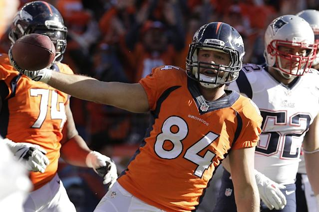 Denver Broncos tight end Jacob Tamme celebrates his one-yard touchdown catch during the first half of the AFC Championship NFL playoff football game against the New England Patriots in Denver, Sunday, Jan. 19, 2014. (AP Photo/Charlie Riedel)