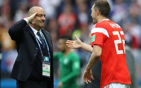Russia coach Stanislav Cherchesov salutes Russia's Artem Dzyuba after he scored their third goal - Credit: REUTERS/Carl Recine