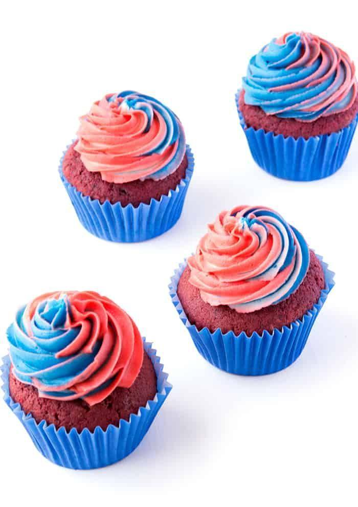 """<p>These red velvet cupcakes have a pretty patriotic swirled frosting and an extra special treat hidden inside: chocolate candies! <strong><br></strong></p><p><strong>Get the recipe at <a href=""""https://www.sweetestmenu.com/fourth-july-red-velvet-pinata-cupcakes/"""" rel=""""nofollow noopener"""" target=""""_blank"""" data-ylk=""""slk:Sweetest Menu"""" class=""""link rapid-noclick-resp"""">Sweetest Menu</a>.</strong><br><br><a class=""""link rapid-noclick-resp"""" href=""""https://go.redirectingat.com?id=74968X1596630&url=https%3A%2F%2Fwww.walmart.com%2Fsearch%2F%3Fquery%3DPIPING%2BTIPS&sref=https%3A%2F%2Fwww.thepioneerwoman.com%2Ffood-cooking%2Frecipes%2Fg36343624%2F4th-of-july-cupcakes%2F"""" rel=""""nofollow noopener"""" target=""""_blank"""" data-ylk=""""slk:SHOP PIPING TIPS"""">SHOP PIPING TIPS</a></p>"""