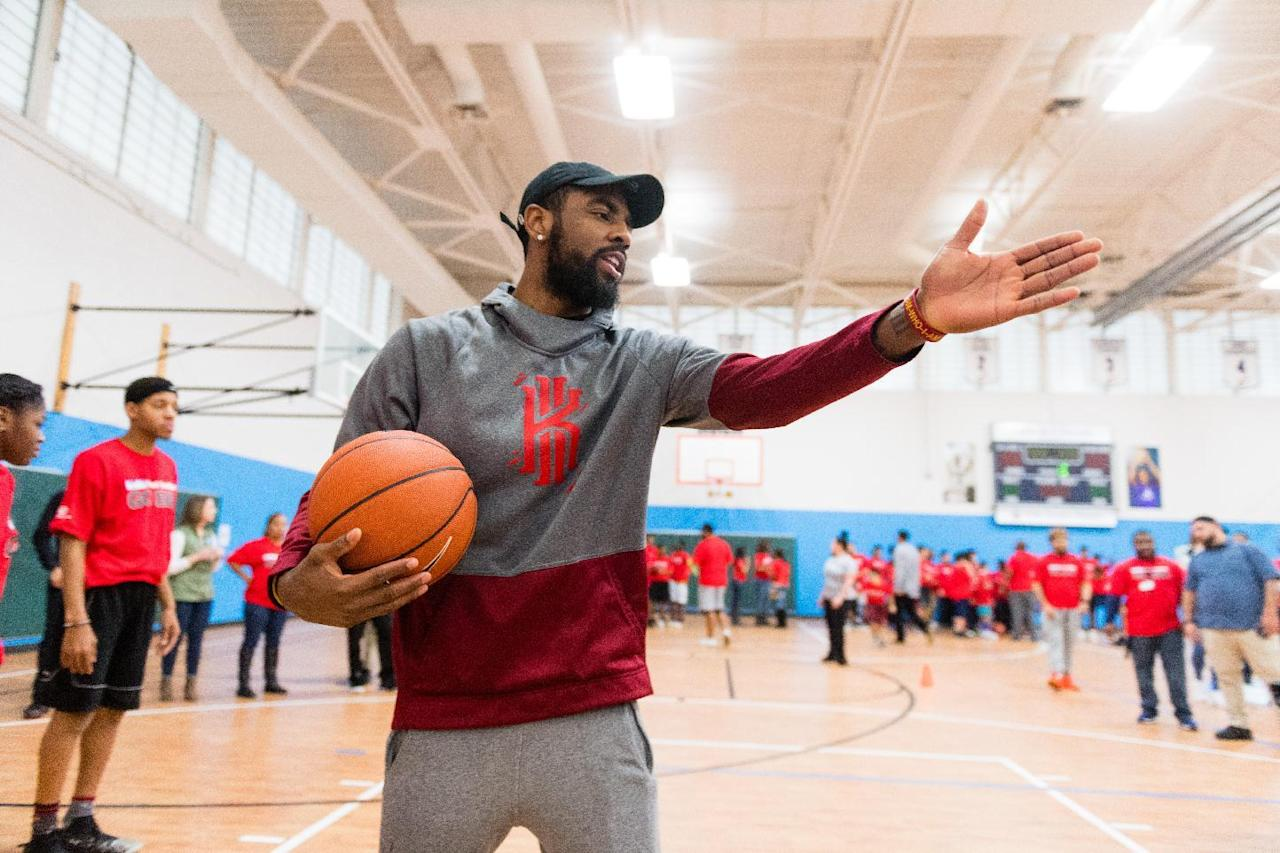IMAGE DISTRIBUTED FOR KIDS FOOT LOCKER - NBA star Kyrie Irving instructs Club kids during the Kids Foot Locker Fitness Challenge kickoff event at Boys & Girls Clubs of Cleveland on Friday, Jan. 20, 2017, in Cleveland. (Jason Miller/AP Images for Kids Foot Locker)