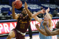 Loyola of Chicago guard Marquise Kennedy (12) drives to the basket ahead of Drake guard Garrett Sturtz, right, during the second half of an NCAA college basketball game, Saturday, Feb. 13, 2021, in Des Moines, Iowa. (AP Photo/Charlie Neibergall)