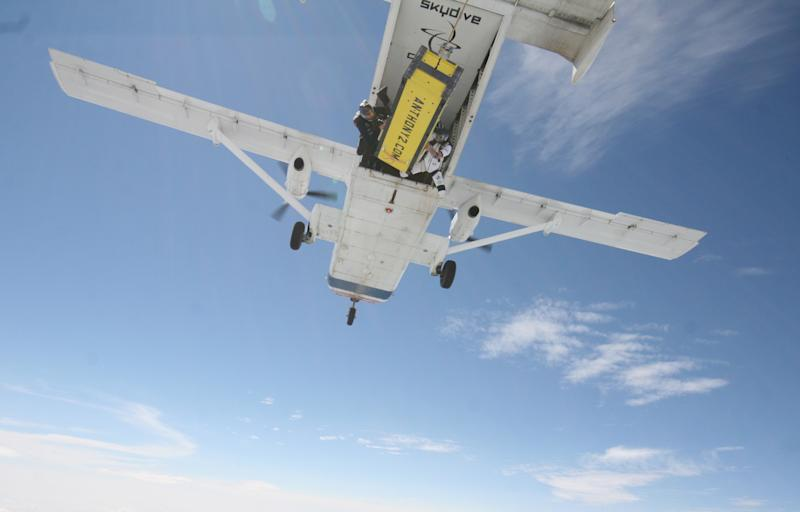 A photo provided by Skydive Chicago shows escape artist Anthony Martin being dropped out of an airplane while being handcuffed and locked inside a box in Ottawa, Ill., Tuesday, Aug. 6, 2013. (AP Photo/Courtesy of Skydive Chicago, Joe Silva)