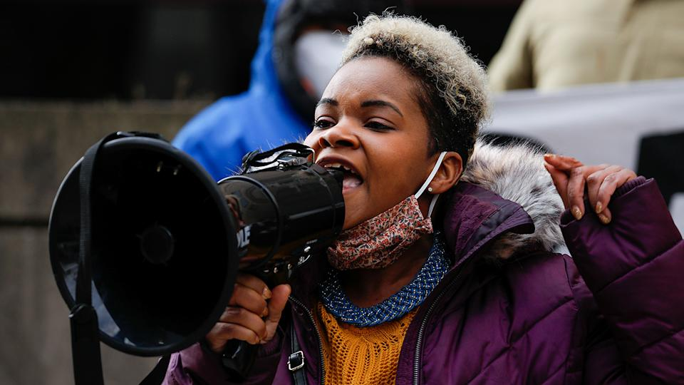 India Walton speaks through a megaphone as she campaigns to replace four-term Mayor Byron Brown, in Buffalo, New York on December 15, 2020. (Reuters/Lindsay DeDario)