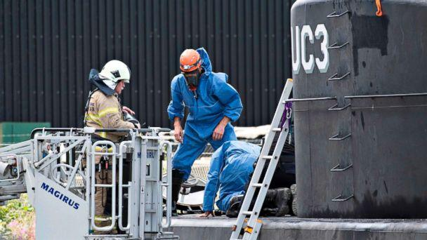 PHOTO: This file photo taken on Aug. 13, 2017 shows police technicians investigating the rescued private owned submarine UC3 Nautilus, in Copenhagen Habour. (Jens Noergaard Larse/AFP/Getty Images, FILE)