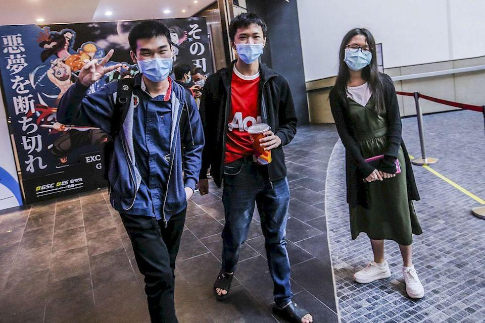 Zenyx (centre), Brayden (left) and Viki (right) speaking to Malay Mail reporters at Mid Valley shopping center cinema, March 5, 2021. ― Picture by Hari Anggara