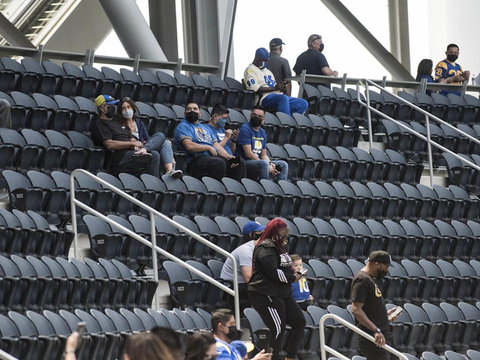 Rams season ticket holders sit in their seats for the first time at SoFi Stadium in Inglewood on Saturday.