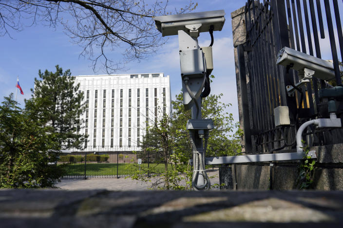 Security cameras are seen on the grounds of the Embassy of the Russian Federation in Washington, Thursday, April 15, 2021. The Biden administration has rolled out a sweeping set of sanctions on Russia over its election interference, hacking efforts and other malign activity. (AP Photo/Carolyn Kaster)